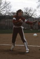 An Augsburg women's softball player reaching to catch ball, May 1983