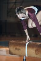 An Augsburg women's gymnastics team member on beam, February 1983