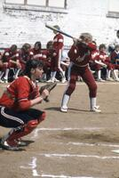 An Augsburg women's softball player at bat, May 1983