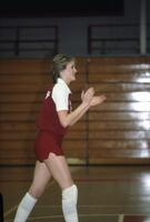 An Augsburg women's basketball player claps, February 1983