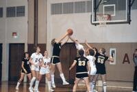 An Augsburg women's basketball player blocking an attempt to score, February 1983