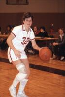 An Augsburg women's basketball player dribbling ball, February 1983