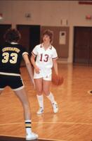 An Augsburg women's basketball player dribbles the ball, February 1983