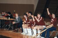 An Augsburg women's basketball players cheer, February 1983