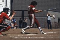An Augsburg women's softball player swinging at ball, May 1983
