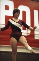 Augsburg women's gymnast with her leg raised, March 1983