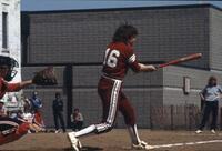 An Augsburg women's softball player mid-swing, May 1983