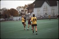 An Augsburg women's soccer team player heads the ball, 1986.