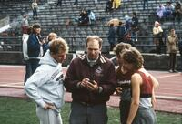 Augsburg's track and field team coach and members, 1986.