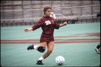 An Augsburg women's soccer team player kicks the ball, 1986.