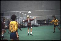 An Augsburg women's soccer team player head a ball, 1986.