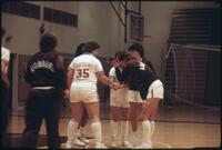 Augsburg women's basketball team players get together before a game, 1987.