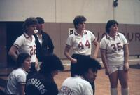 Augsburg women's basketball team players during a timeout, 1987.