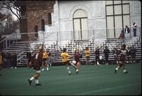 An Augsburg women's soccer team player attempts to block a shot, 1986.