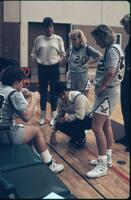 Augsburg women's basketball team coach talks to the players, 1986.