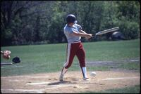 Augsburg women's softball team player hits a ball, 1985.