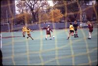 An Augsburg women's soccer team player attempts a pass, 1986.
