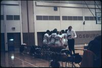 Augsburg women's basketball team huddles up during a timeout, 1986.