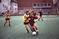 An Augsburg women's soccer team player dribbles, 1986.