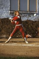 An Augsburg women's softball team player hits the ball, 1984.