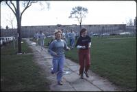 Augsburg women's track and field team runners jog around campus, 1984.