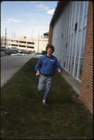 An Augsburg women's track and field team runner warms up, 1984.