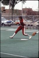 An Augsburg women's softball team player hits the ball, 1985.