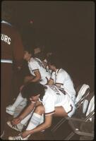 An Augsburg women's basketball team player laces her shoes, 1984.