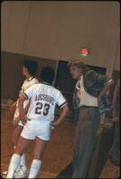 An Augsburg women's basketball team player talks to a coach during a timeout, 1985.