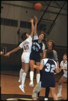 An Augsburg women's basketball team player jumps up, 1984.