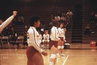 Augsburg women's volleyball team compete in a match, 1985.