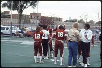 Augsburg women's softball team celebrate after a game, 1985.