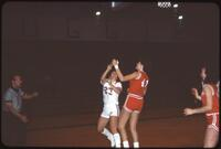 An Augsburg women's basketball team player goes in for a layup, 1984