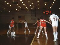 An Augsburg women's basketball team player passes the ball, 1984.