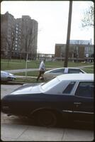 Unknown man walking along the edge of Murphy Square, 1984.