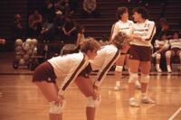 Augsburg women's volleyball team players get ready for a match, 1985.