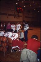 Augsburg women's basketball team players listen to their coach during a timeout, 1984.