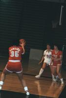 An Augsburg women's basketball team player defends an opponent, 1984.