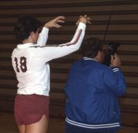 An Augsburg women's volleyball team player mocks her teammate as she gets her picture taken, 1984.