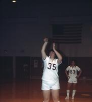 An Augsburg women's basketball team player shoots a free throw, 1984.