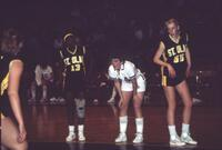 An Augsburg women's basketball team player waits for the rebound from a free throw, 1984.