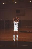An Augsburg women's basketball team player takes a shot, 1984