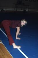 An Augsburg women's gymnastics team member does a split, 1984.
