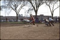 An Augsburg women's softball team player throws the ball, 1984.