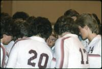 Augsburg women's volleyball team huddle up before a match, 1984.