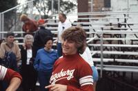 An Augsburg women's softball team player smiles for a picture, 1985.