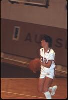 An Augsburg women's basketball team player dribbles, 1984.