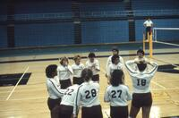 Augsburg women's volleyball team players get in a huddle before a match, 1985.