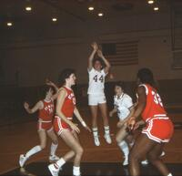 An Augsburg women's basketball team player takes a shot from the free throw line, 1984.