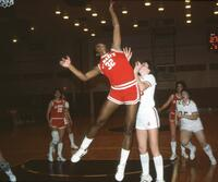 An Augsburg women's basketball team player tries to block an opponent from rebounding, 1984